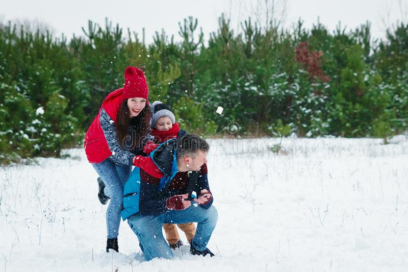 Happy family in warm clothes in the winter outdoors. Concept of holidays, holidays, winter, new year, day of grace. Family. Relationships, happy marriage stock image