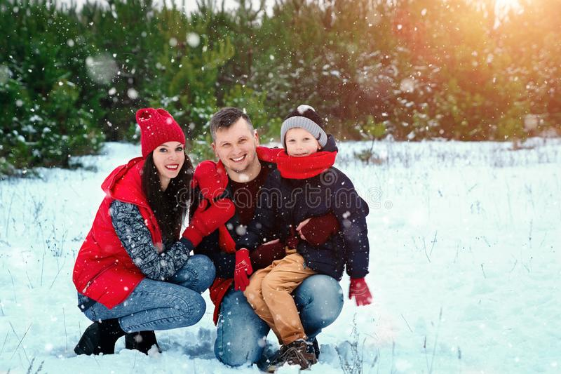 Happy family in warm clothes in the winter outdoors. Concept of holidays, holidays, winter, new year, day of grace. Family. Relationships, happy marriage royalty free stock image