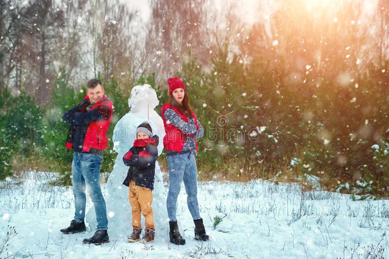 Happy family in warm clothes in the winter outdoors. Concept of holidays, holidays, winter, new year, day of grace. Family. Relationships, happy marriage royalty free stock photos