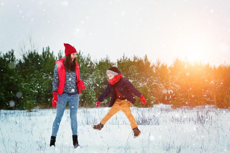 Happy family in warm clothes in the winter outdoors. Concept of holidays, holidays, winter, new year, day of grace. Family. Relationships, happy marriage stock photos