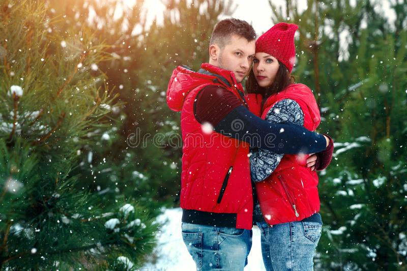 Happy family in warm clothes in the winter outdoors. Concept of holidays, holidays, winter, new year, day of grace. Family. Relationships, happy marriage stock photo