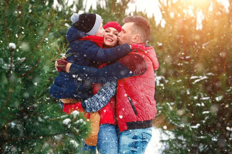 Happy family in warm clothes in the winter outdoors. Concept of holidays, holidays, winter, new year, day of grace. Family. Relationships, happy marriage stock photography