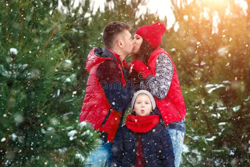 Happy family in warm clothes in the winter outdoors. Concept of holidays, holidays, winter, new year, day of grace. Family. Relationships, happy marriage royalty free stock photo