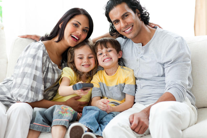 Happy Family Watching TV Together Stock Photo