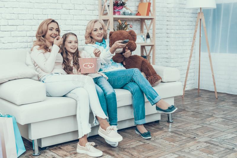 Happy Family Watching Video with Toy Bear at Home royalty free stock images