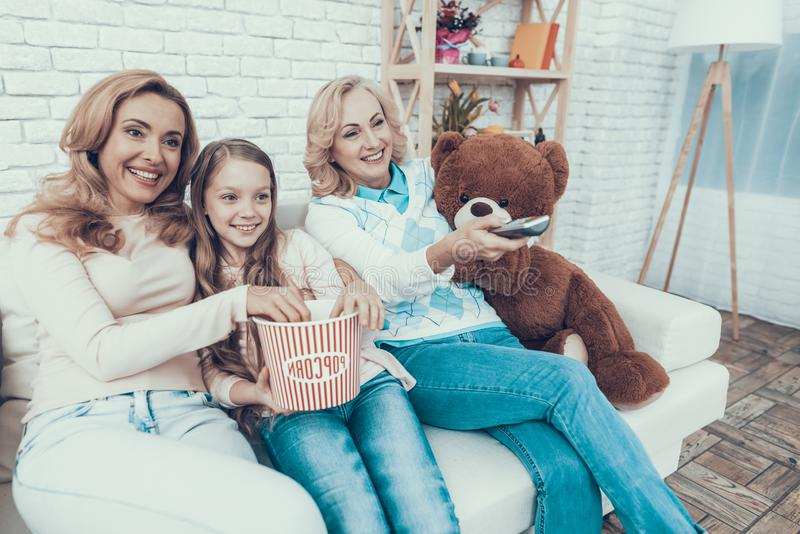 Happy Family Watching Video with Toy Bear at Home. stock photography