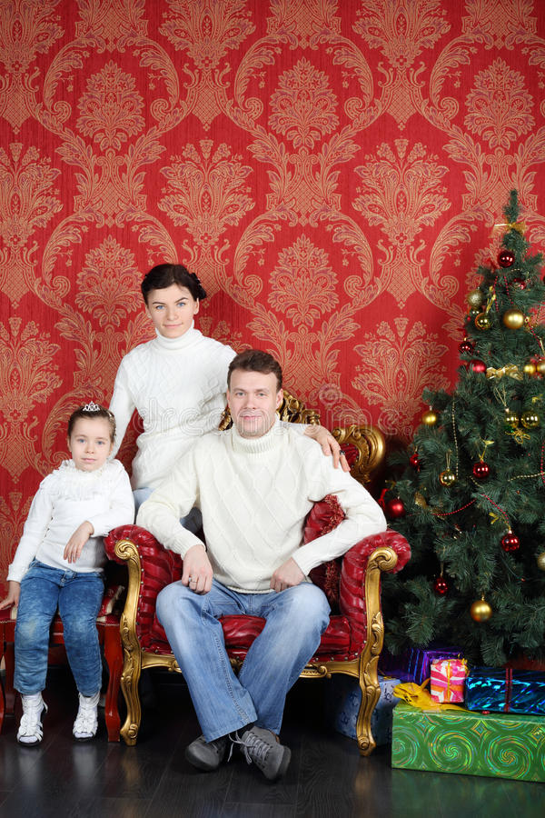 Download Happy Family In White Sweaters And Jeans Near Christmas Tree Stock Photo - Image: 34550634