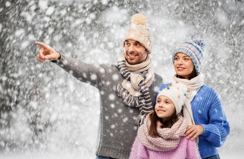 Happy family in winter clothes on snow background royalty free stock image