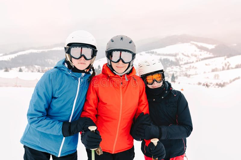 Happy family in winter clothing at the ski resort stock image