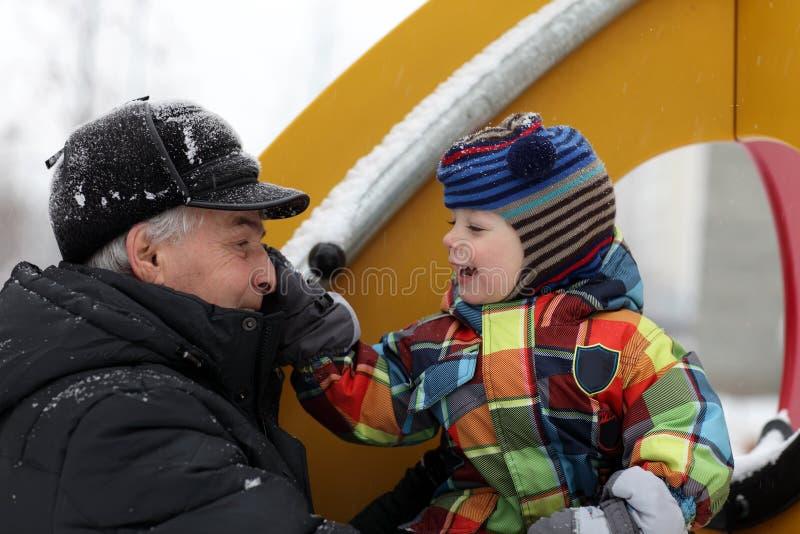 Happy family at winter playground royalty free stock photos