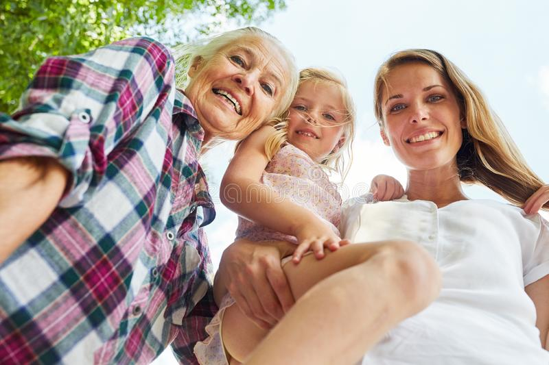 Happy family with women in 3 generations stock images