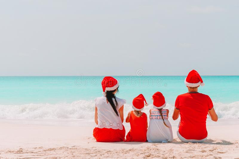 Happy family with two kids in Santa Hat on summer vacation royalty free stock photography