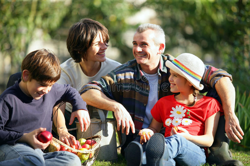 Download Happy Family In A Yard Royalty Free Stock Images - Image: 14489439