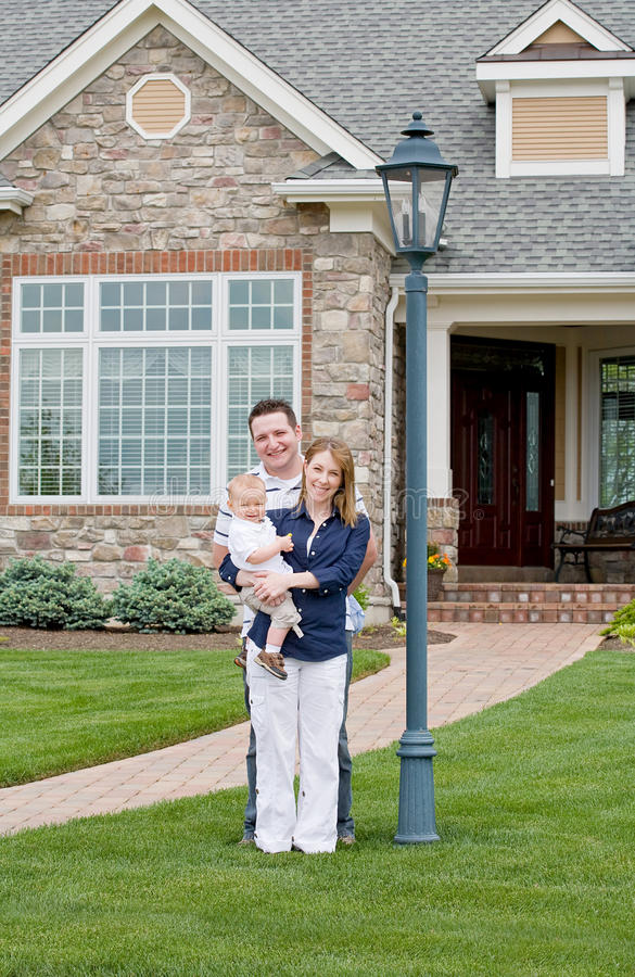 Happy Family in Yard stock images