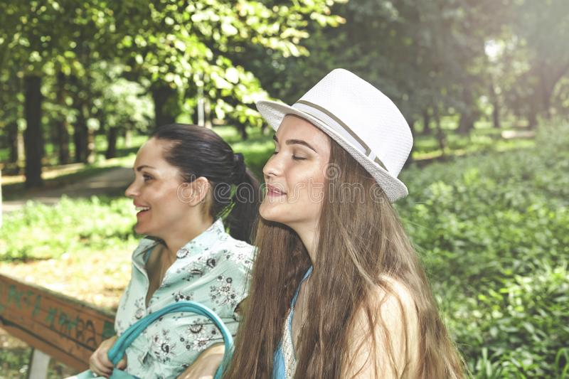 A happy family. Young beautiful mother and teenager daughter having fun laughing on a walk stock photography