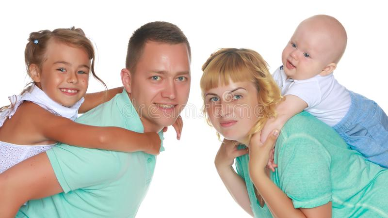 Happy family with young children stock photography
