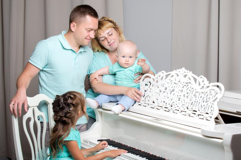Happy family with young children stock images