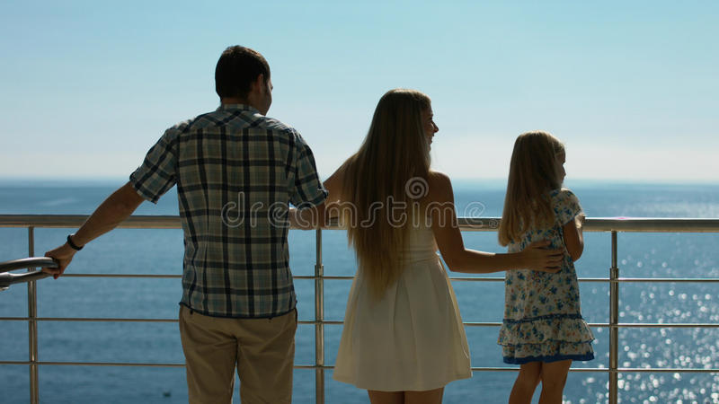 Happy family with young children standing outdoors royalty free stock photo