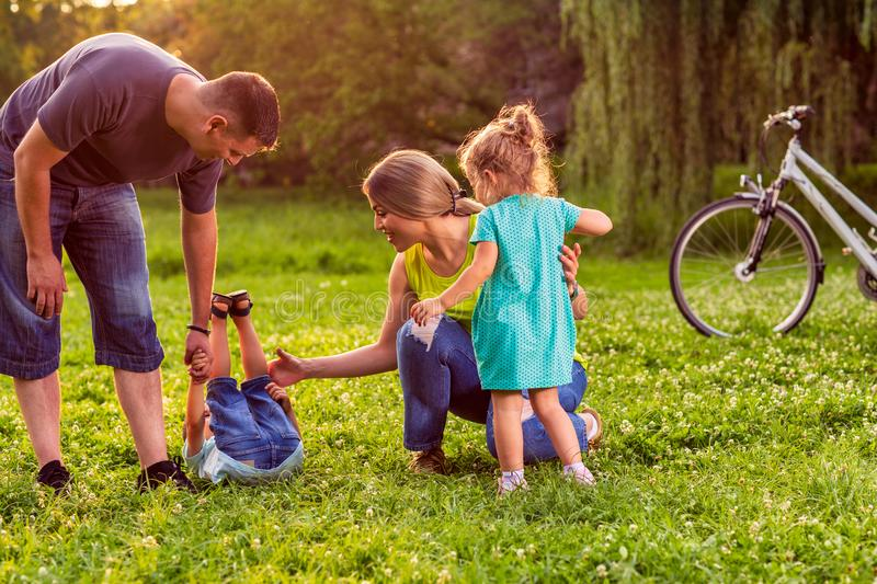 Happy family- young couple with their children have fun at beaut stock images
