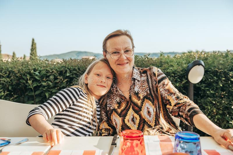 Happy family, young grandmother with little grandaughter spending time together royalty free stock photography