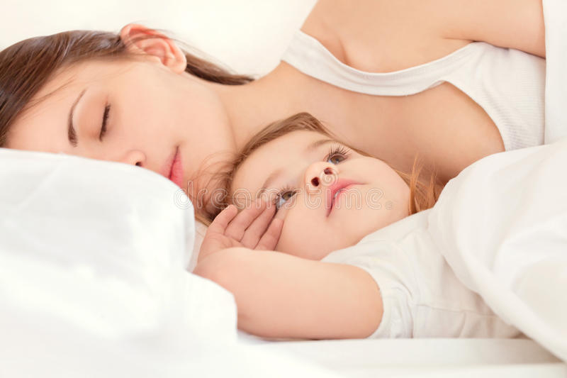 Happy family.A young mother and baby stock photos