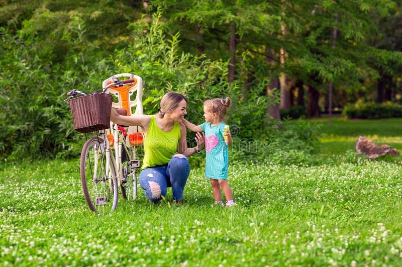 Happy family. young mother and her daughter in the park stock image