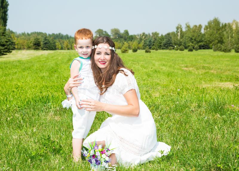 Happy family. Young mother and kid boy on sunny day. Portrait mom and son on nature. Positive human emotions, feelings, joy. royalty free stock image