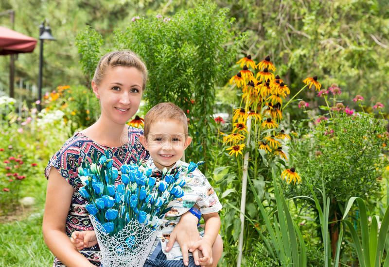 Happy family. Young mother and kid boy on sunny day. Portrait mom and son on nature. Positive human emotions, feelings, joy. royalty free stock photography