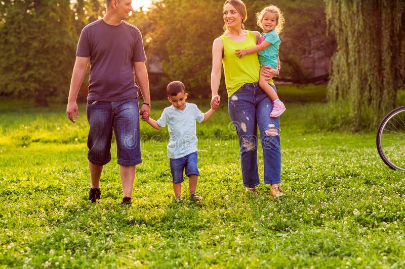 Happy family- Young family together enjoying in park royalty free stock images