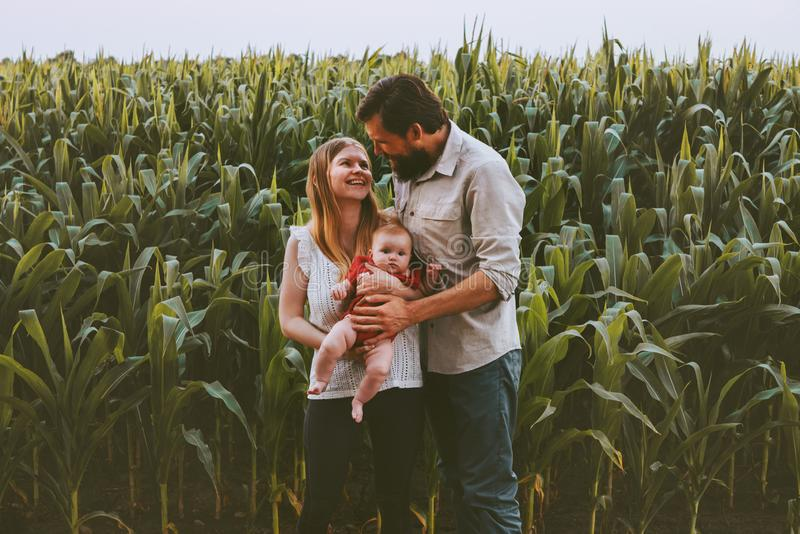 Happy farmers family parents with infant baby outdoor stock photos