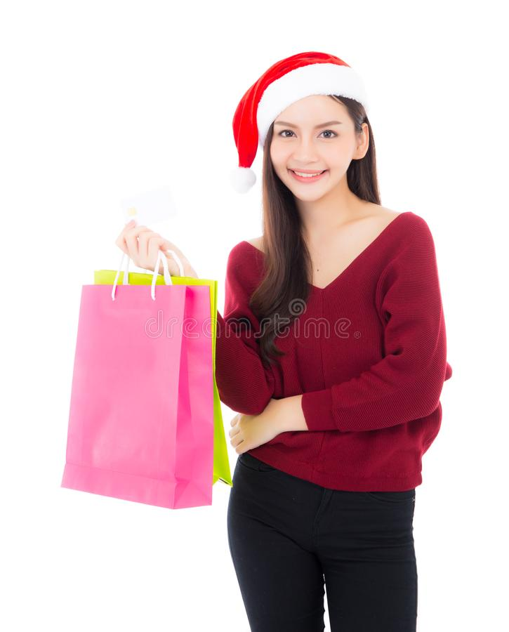 Happy fashion asian woman with smile holding shopping paper bag. And credit card, Sale and christmas with holiday, girl with buyer enjoy and excited isolated on royalty free stock photo