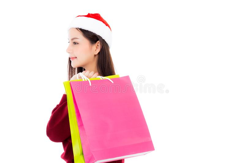 Happy fashion asian woman with smile holding shopping paper bag. Sale and christmas with holiday, girl with buyer enjoy and excited isolated on white royalty free stock images