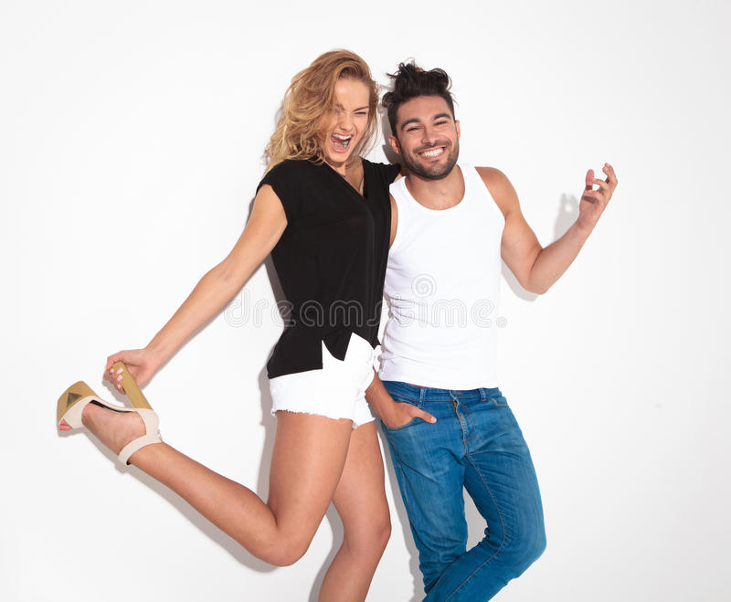 Happy fashion couple celebrating together royalty free stock photo