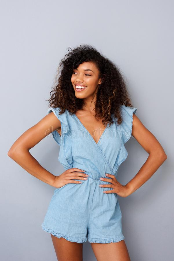Free Happy Fashion Model Smiling Against Gray Background Royalty Free Stock Photos - 109419198