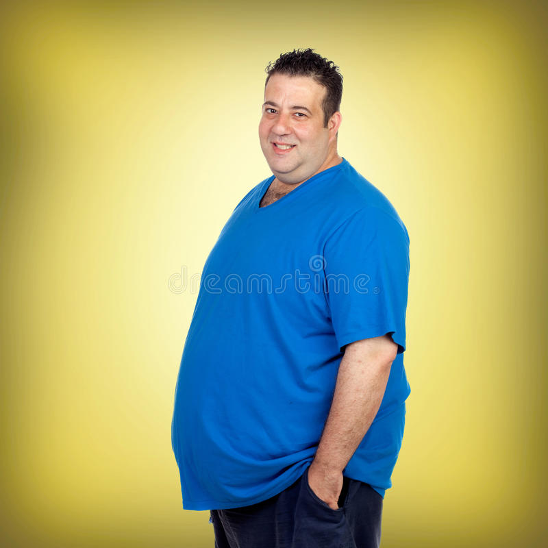 Happy fat man with blue shirt royalty free stock photo