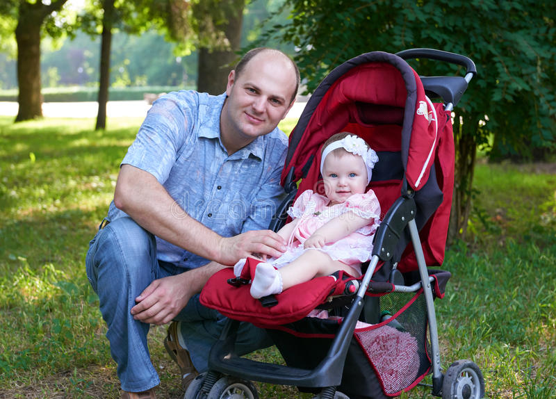 Happy father with baby girl portrait in city park, summer season, child and parent royalty free stock photography