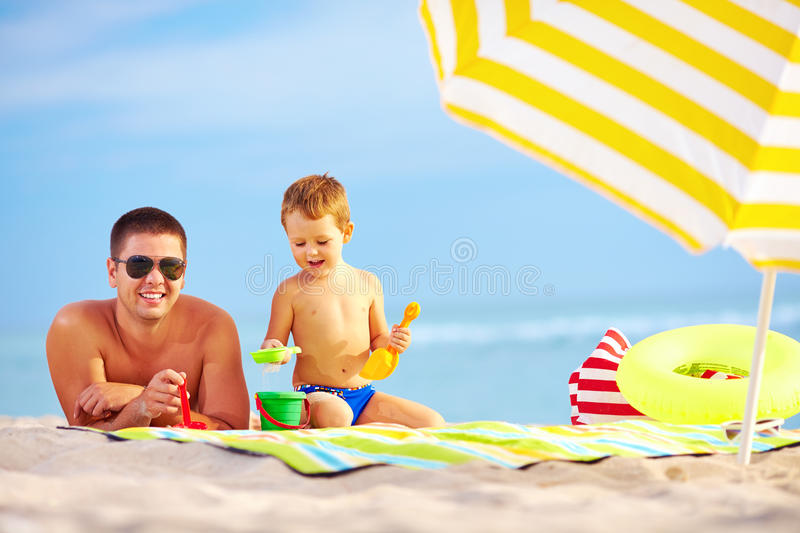 Download Happy Father And Child Having Fun On The Beach Stock Photo - Image of play, game: 34113552