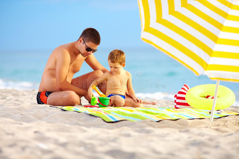 Download Happy Father And Child Playing On The Beach Stock Photo - Image: 34117602