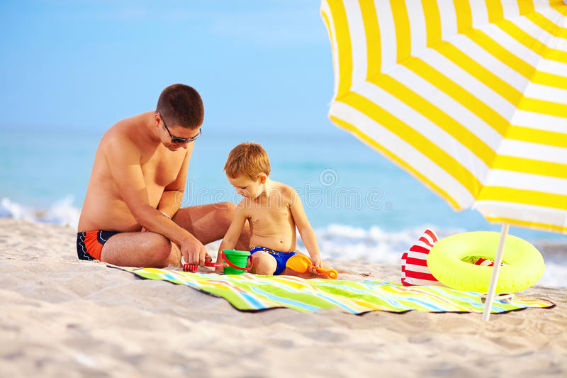 Download Happy Father And Child Playing On The Beach Stock Photo - Image of cute, child: 34117716