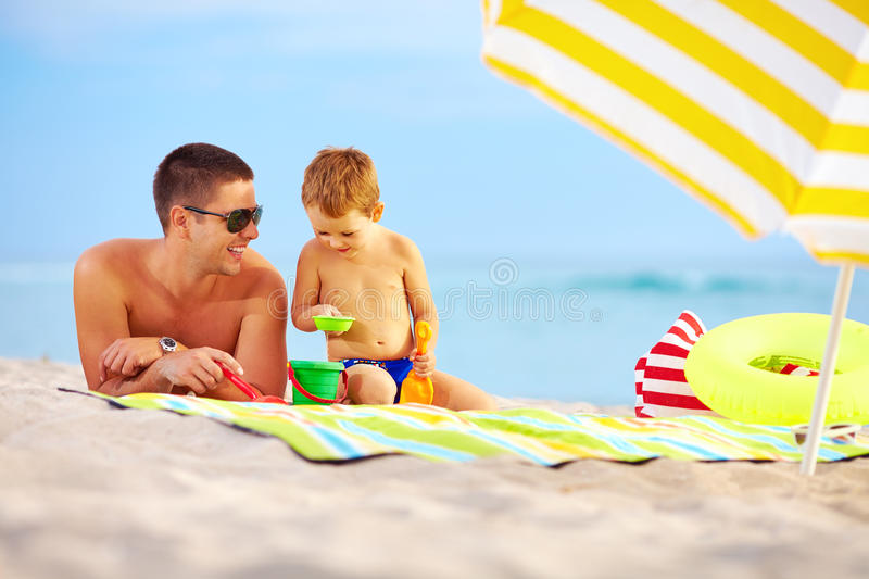 Download Happy Father And Child Playing On The Beach Stock Image - Image: 34117781