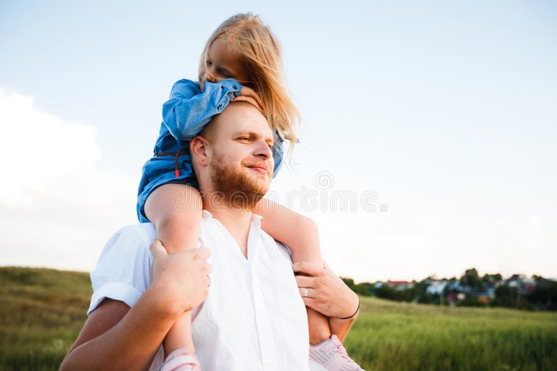 Happy father and child spending time outdoors. Beautiful blonde daughter. royalty free stock photography