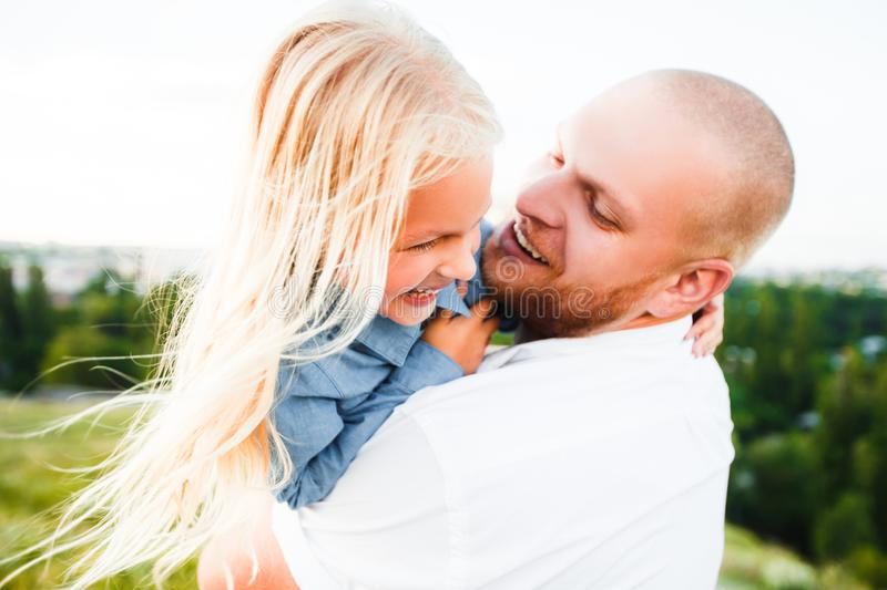 Happy father and child spending time outdoors. Beautiful blonde daughter. royalty free stock photo
