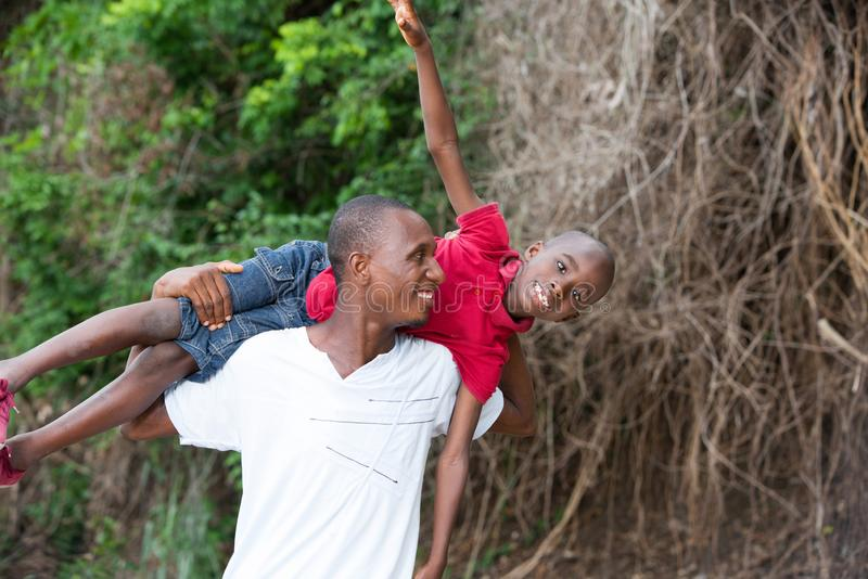 Happy father and child spending time outdoors and laughing. Portrait of father with his son having fun in the park. Family fun happy boy playing with dad stock images