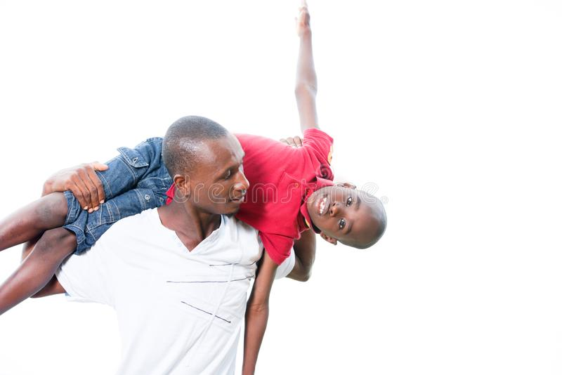 Happy father and child spending time outdoors and laughing. Portrait of father with his son having fun in the park. Family fun happy boy playing with dad royalty free stock photography