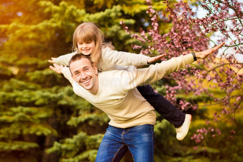 Happy father and child spending time outdoors. Family support stock images