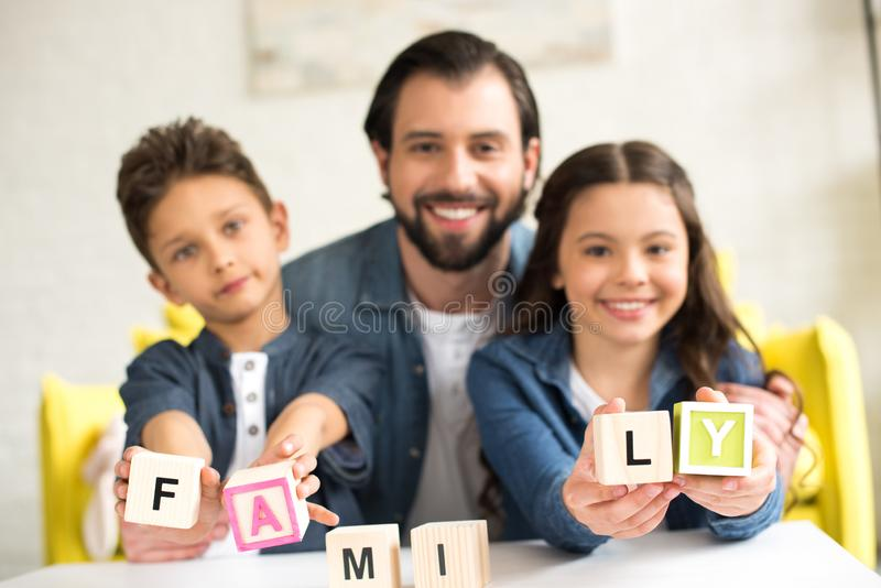 happy father with cute little children stock image