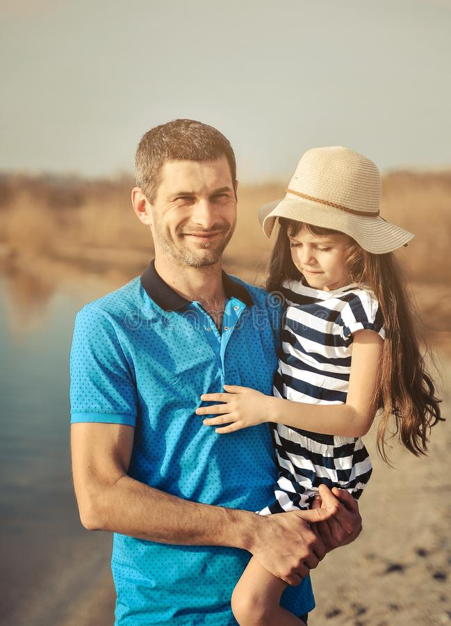 Happy father and daughter on the beach. Father`s day concept. stock photos