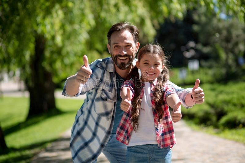 Happy Father And Daughter In City Park Showinh Together Thumb up. Happy Loving Family Concept. stock images