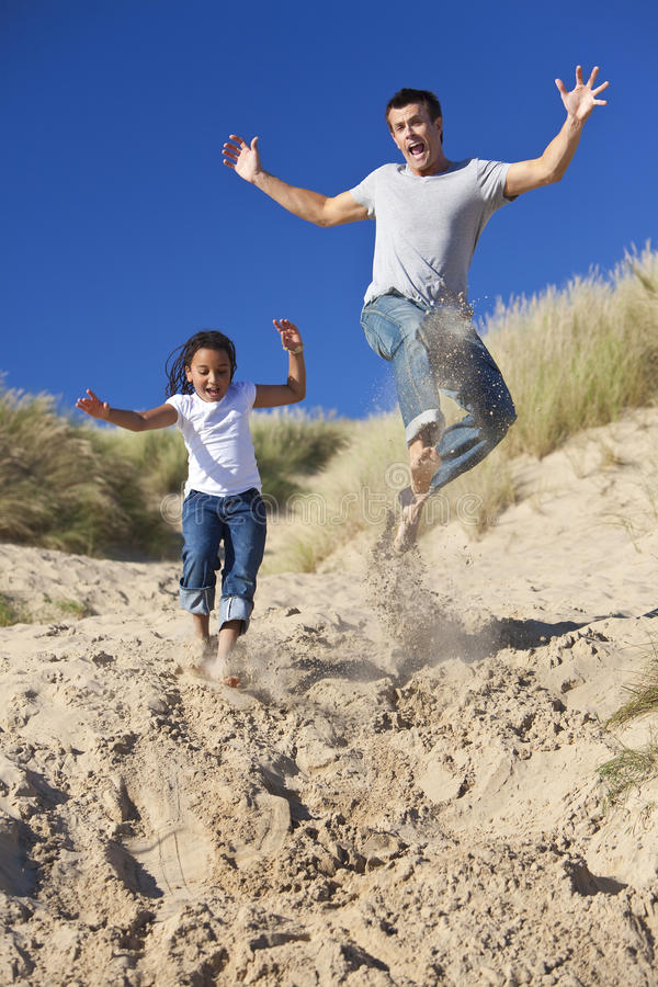 Download Happy Father And Daughter Jumping At Beach Stock Photo - Image: 16503062