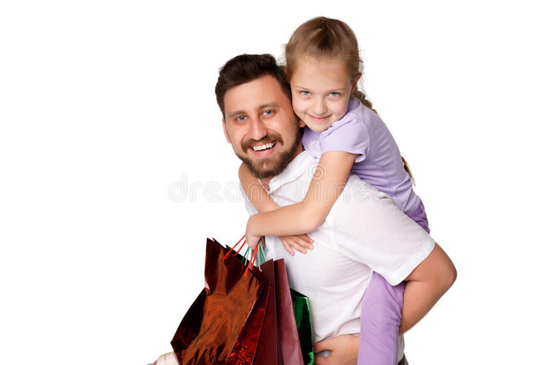 Happy father and daughter with shopping bags royalty free stock photo